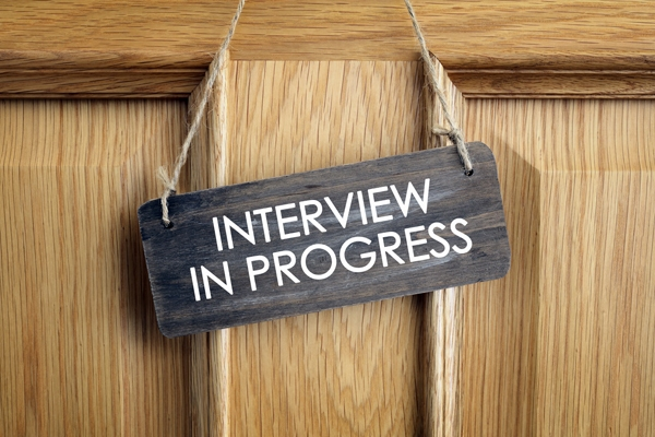 Interview in progress sign on door
